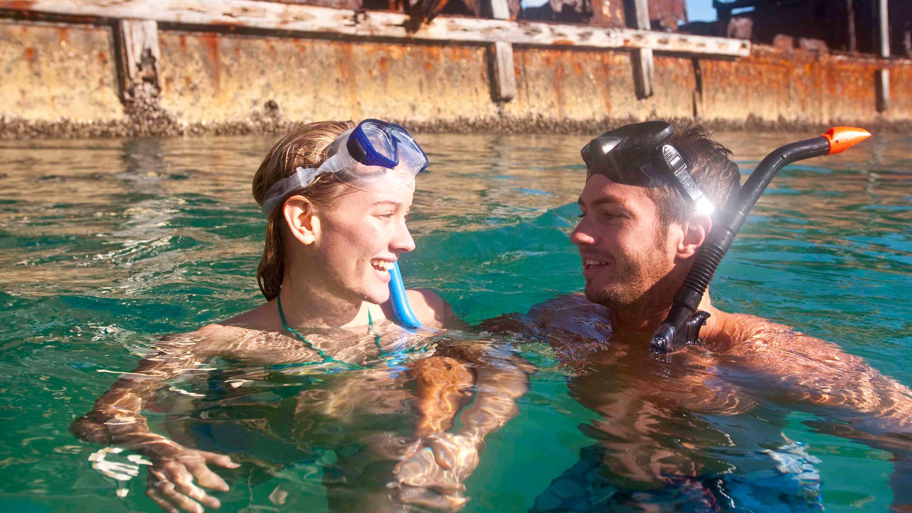 Snorkeling couple in Moreton Island
