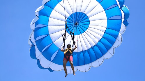 Person parachuting in Bali