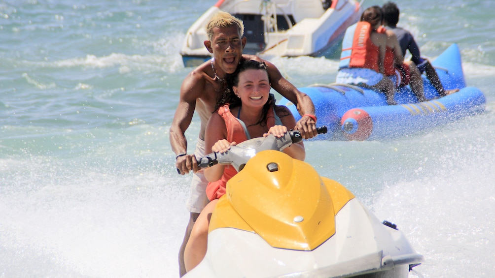 Show item 8 of 8. Young man and woman jet skiing in Bali