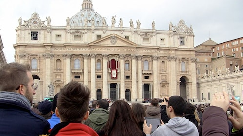 Large crowd outside St. Peter's Basilica in Vatican City