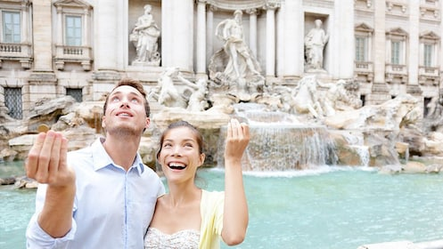 Couple standing at Trevi Fountain in Rome