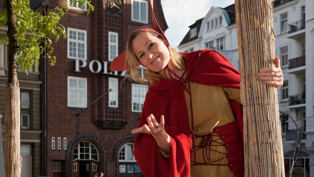 Tour guide in red and yellow costume in hamburg