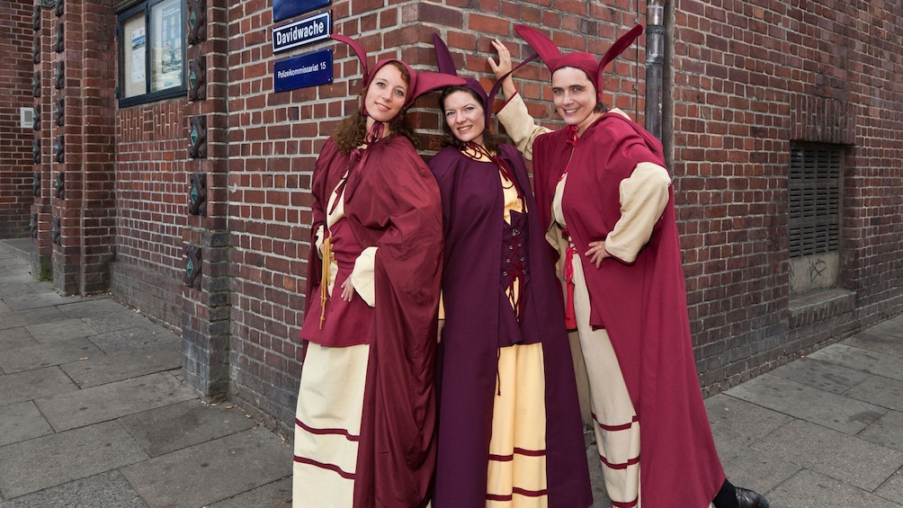 Costumed tour guides in the red light district in Hamburg