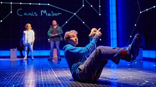 Actors looking at constellations onstage in London
