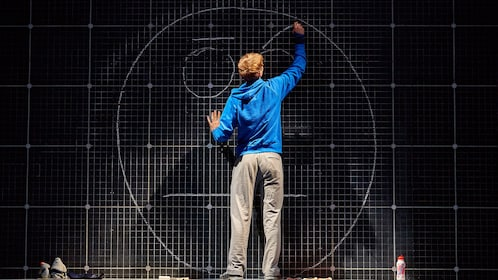 Actor drawing the wall during The Curious Incident of the Dog at Night in London