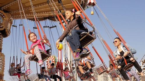 Kids in the swing ride at Coney Island in New York