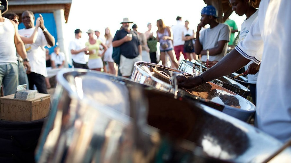 Show item 5 of 7. People dancing to steel drum music being played in Antigua