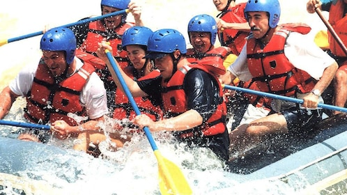 white water rafters fighting the rapids in Kota Kinabalu