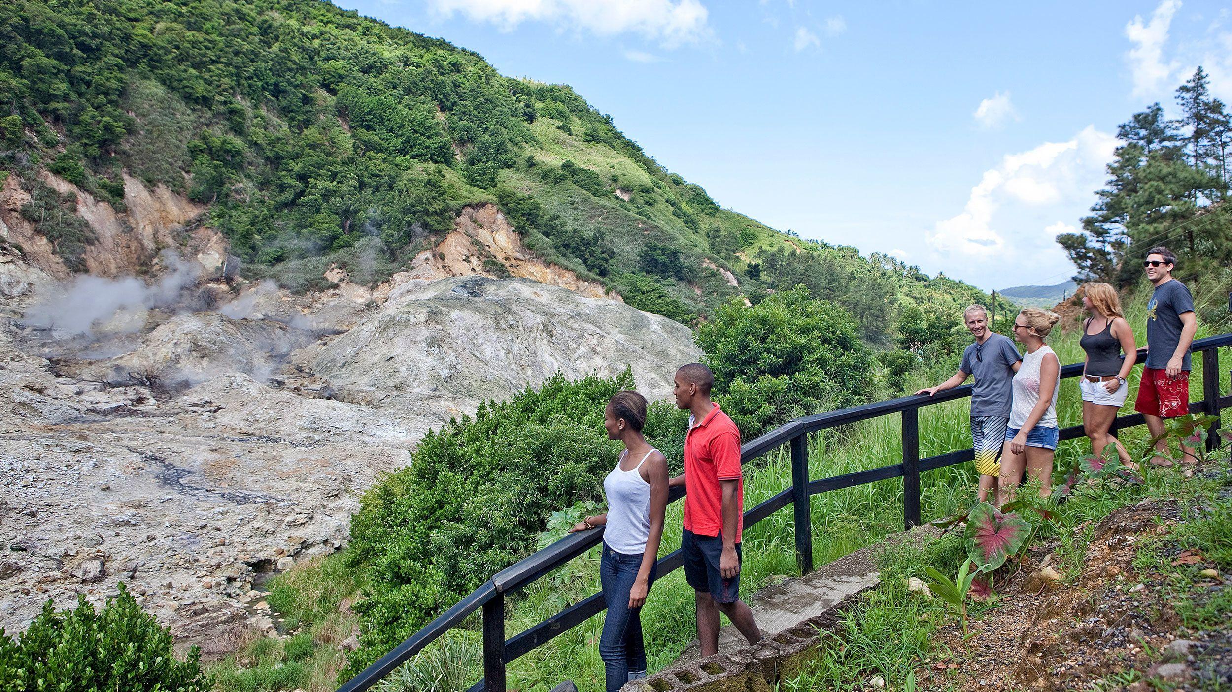 group hiking down a steep decline in Saint Lucia