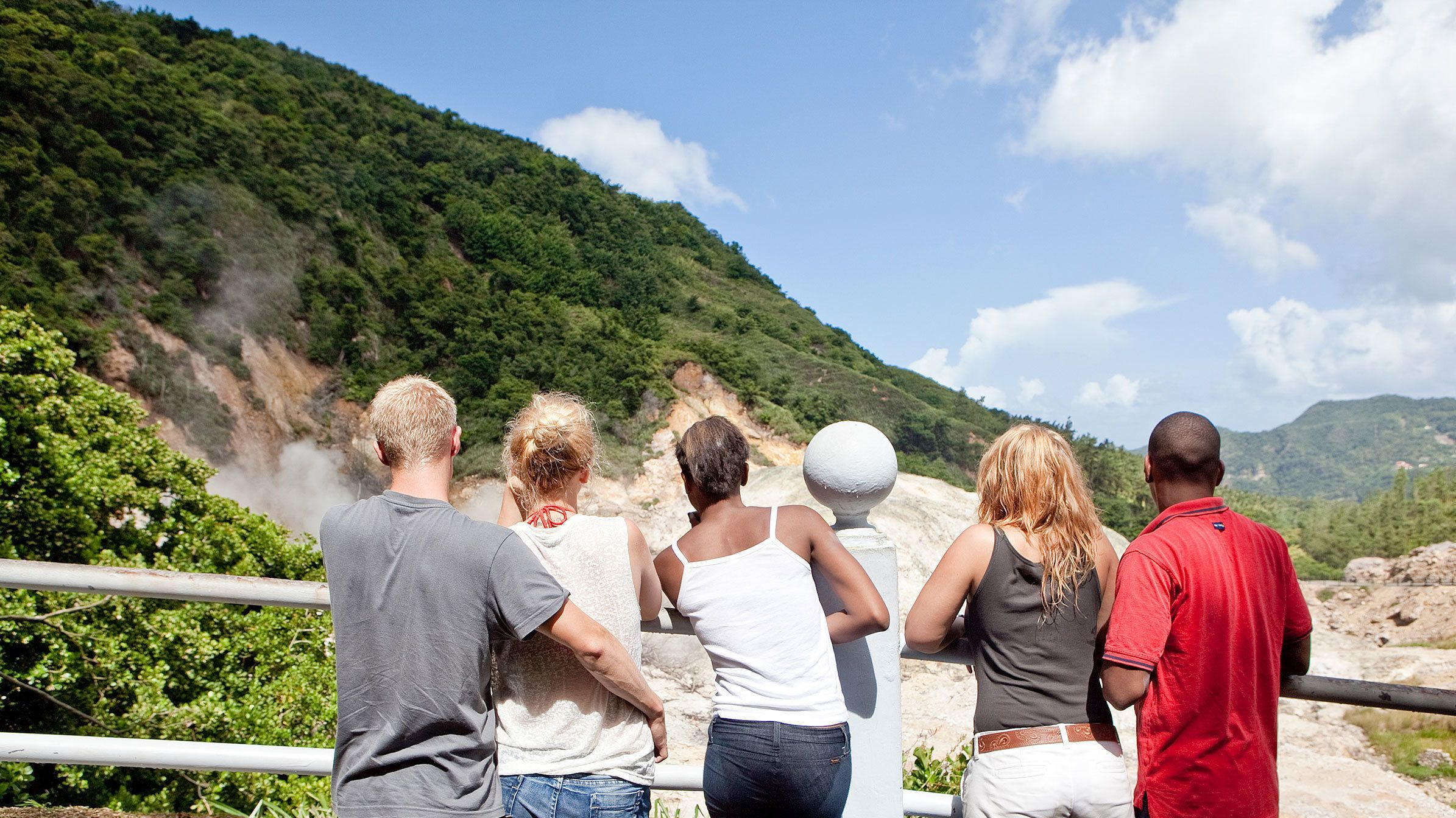 group looking at mountains from a rail in Saint Lucia