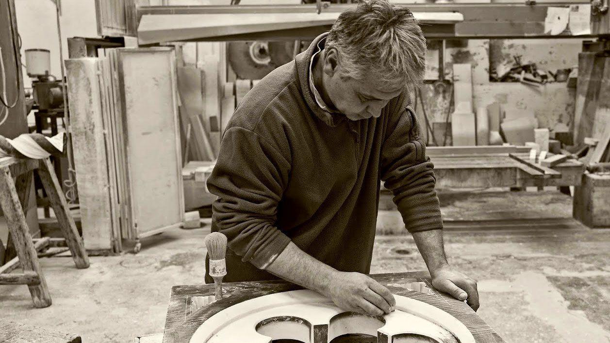 restoration expert sanding parts in Florence