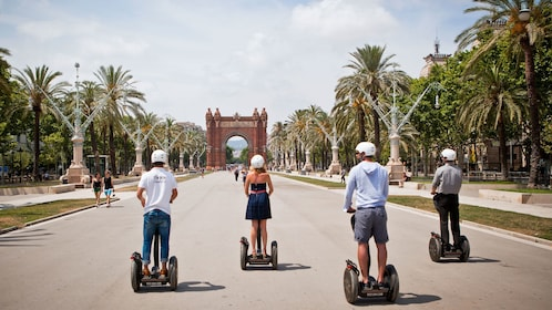 Segway riding group approaching the Arc de Triomf in Barcelona