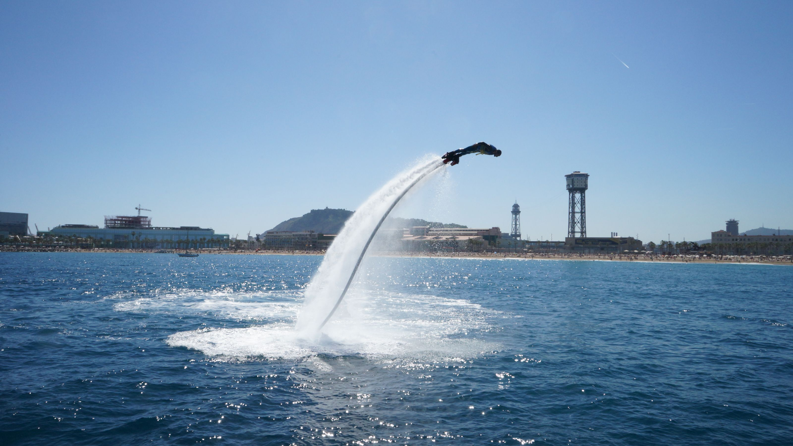 Person in the air using flyboard in barcelona