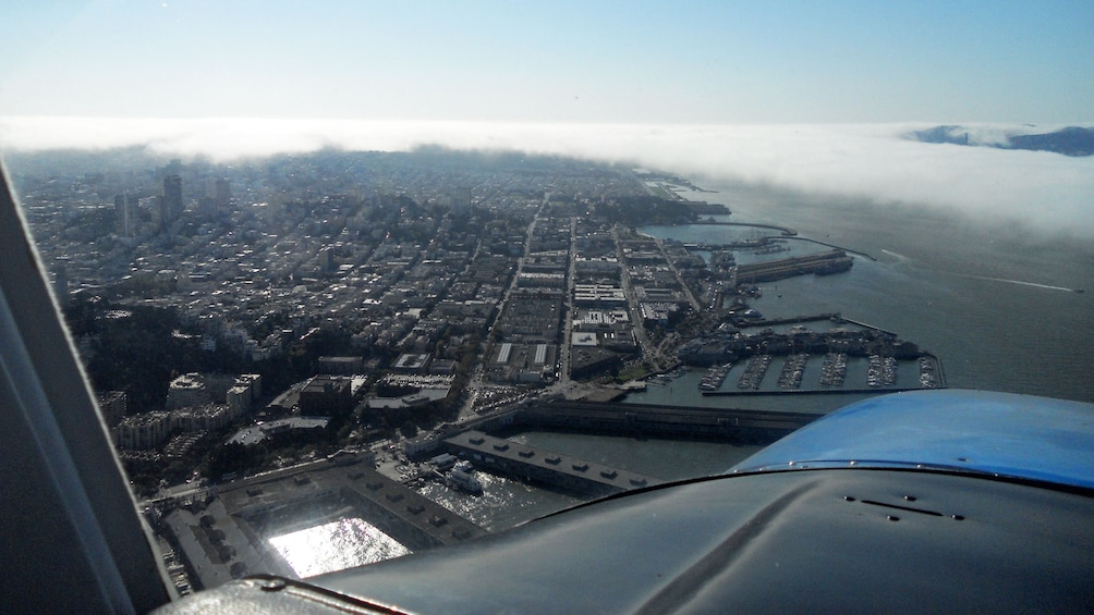 Show item 8 of 8. Plane flying over San Francisco