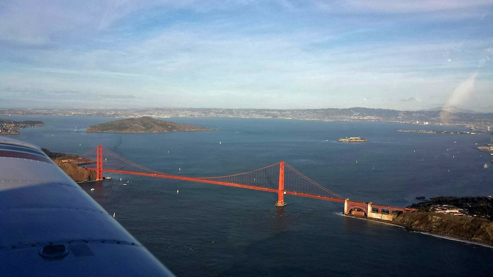 Show item 3 of 8. View of Golden Gate Bridge from airplane