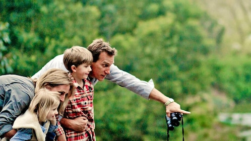 family looking at wildlife with binoculars in Australia