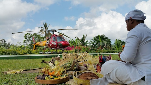 man crafting organic goods near a helicopter in Bali