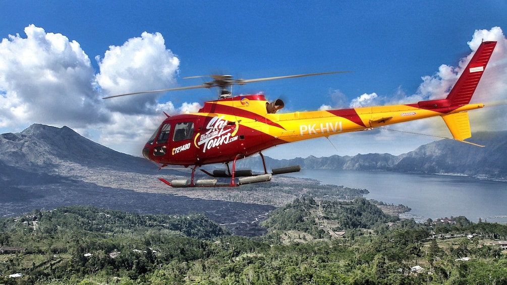 Tampilkan item 1 dari 5. helicopter flying over the green landscape in Bali