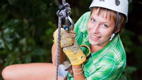 ziplining woman holding on to her harness in Saint Lucia