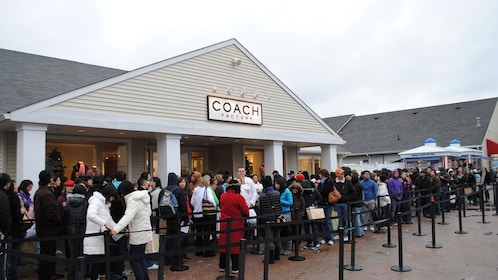 Customers lined up in front of the Coach Factory store at the Woodbury Common Outlet Shopping Mall