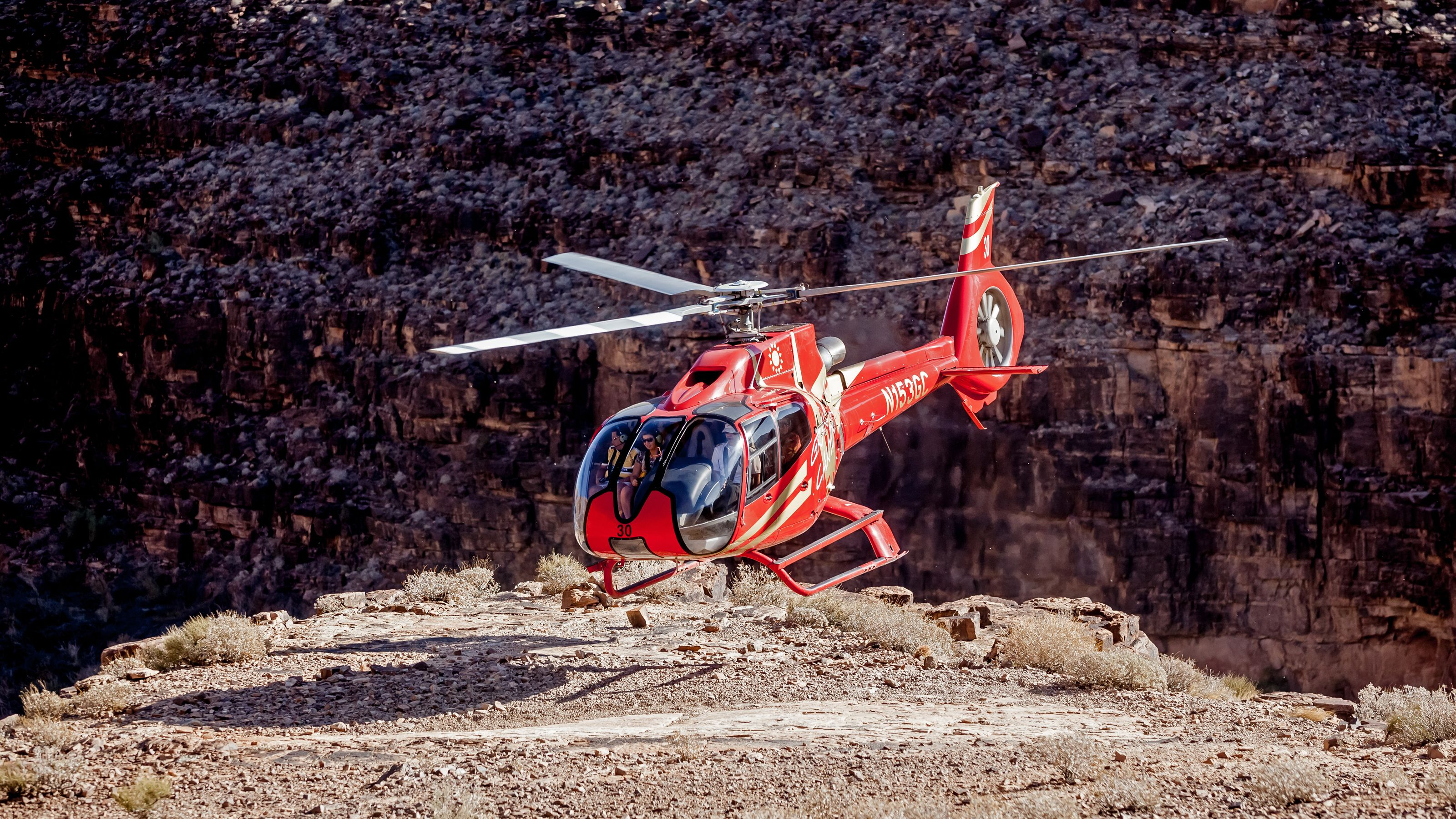 red helicopter in mountainous area in nevada