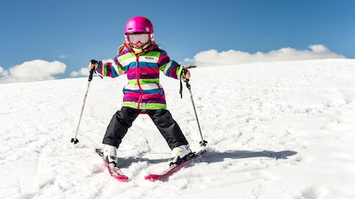 Child learning how to ski