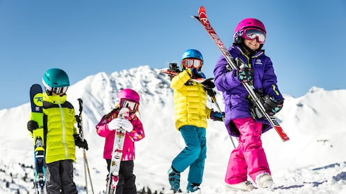 Kids preparing to ski down the slopes