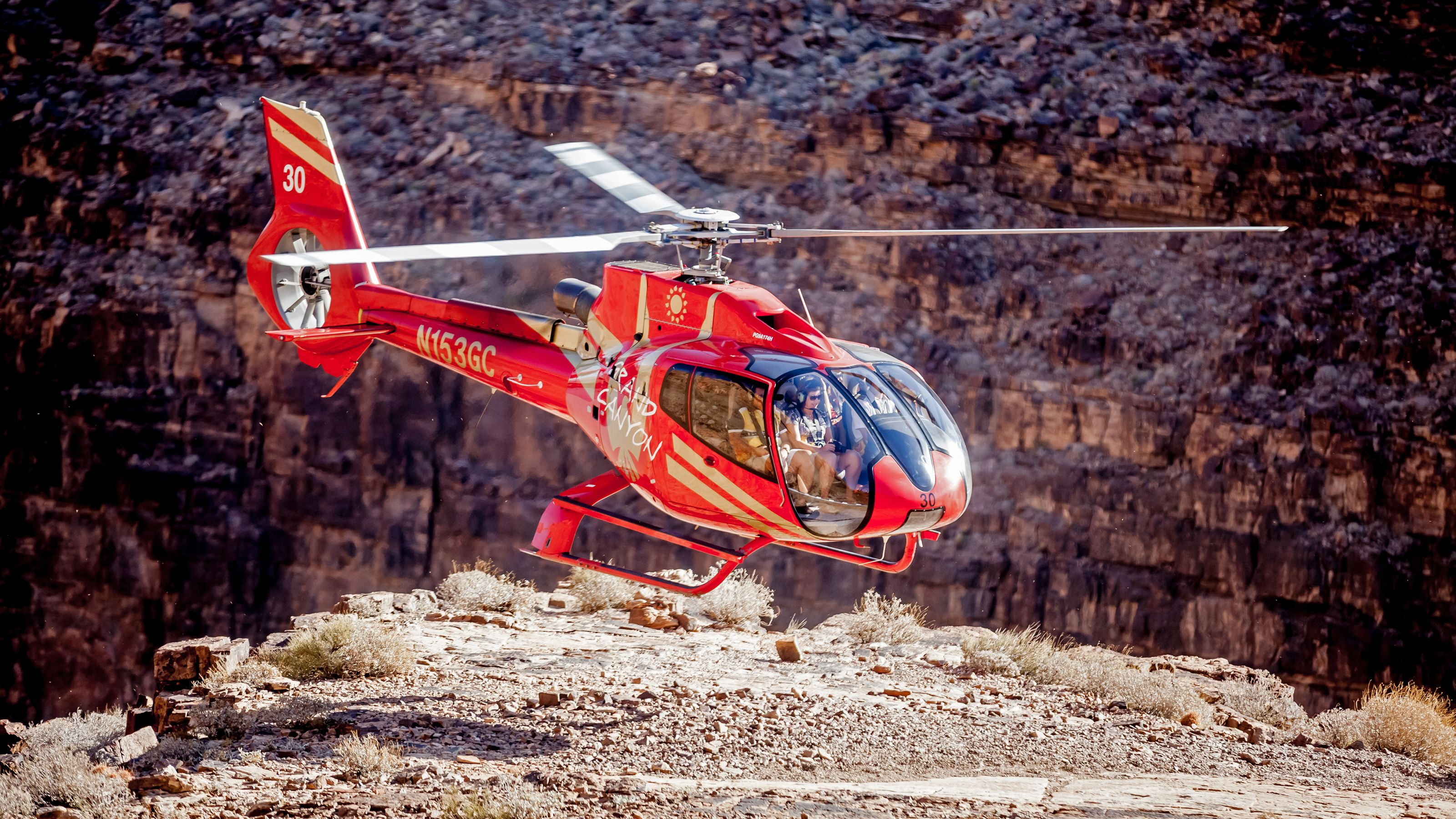 red helicopter landing in mountainous area in nevada