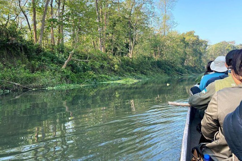 Show item 4 of 9. Canoeing in Chitwan National Park