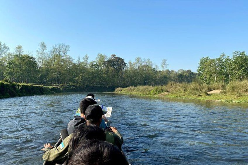 Show item 5 of 9. Canoeing in Chitwan National Park