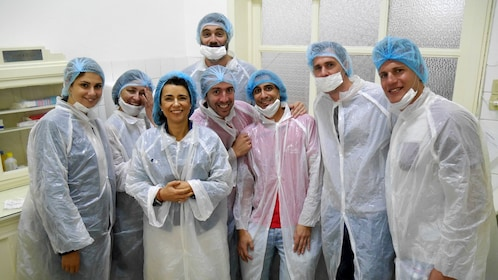 Group wearing hairnets and plastic gowns in Porto