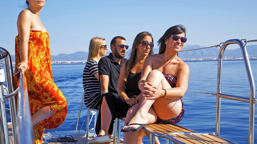 People in swimsuits on deck of Catamaran