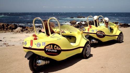 Two sea cars facing the beach