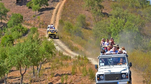 Jeeps on dusty road in Portugal