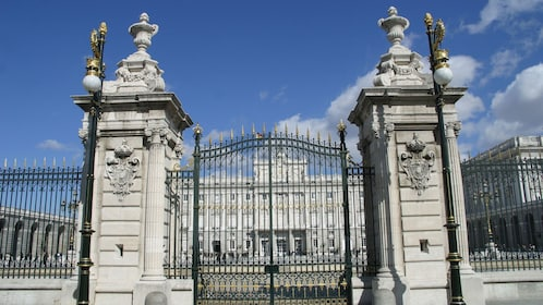 Gated entrance to old Madrid building with beautiful architecture.
