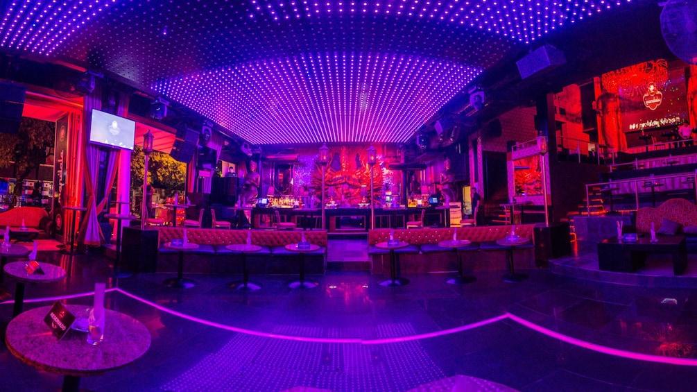 Show item 1 of 5. Interior view of empty nightclub bar.