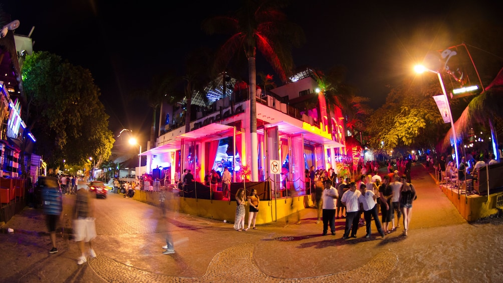 Show item 3 of 5. Exterior view of nightclub with partygoers in front.