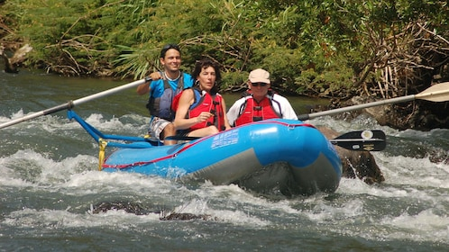 Couple with guide on a river float in Costa Rica