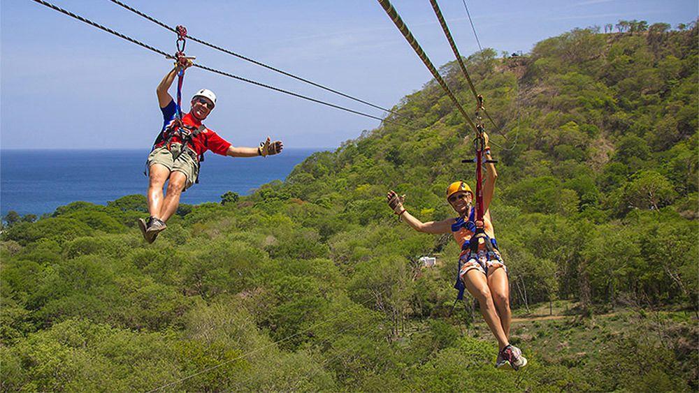 Two guests enjoying a ziplining adventure in Costa Rica
