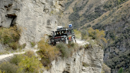 Jeep driving down narrow road in Skippers Canyon.
