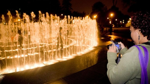 Lights brighten up the water features at the Magic Circuit Water Show