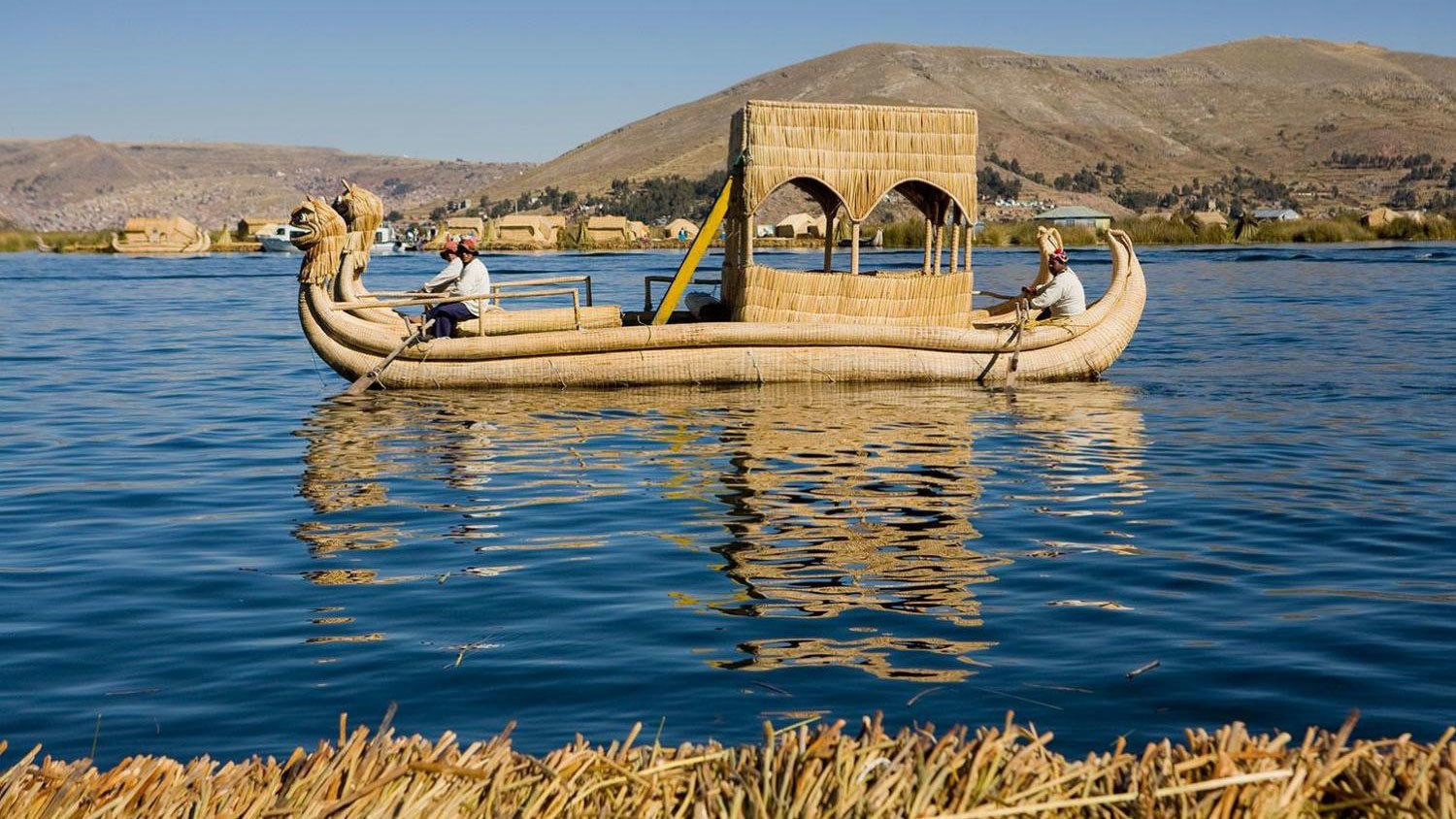 Small wooden boat in Lake Titicaca