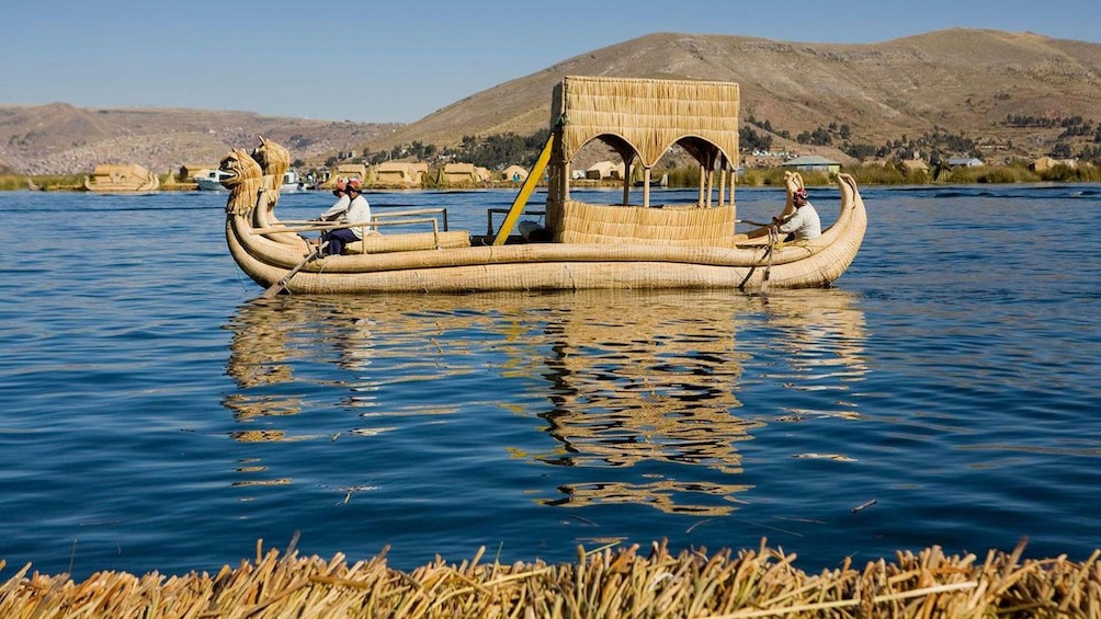 Show item 2 of 5. Small wooden boat in Lake Titicaca