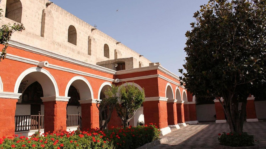 Show item 3 of 5. Arched walkway of a church in Peru