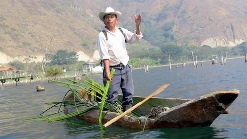 Man on a boat in the Santiago Atiltlan Village of Guatemala