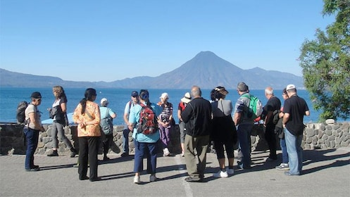 Tour group viewing Lake Atiltlan of Guatemala which is the deepest lake in Central America