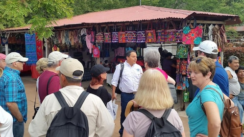 Tour group with guide at a market in Antigua