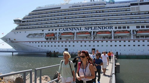 Tour group disembarking from cruise ship in Antigua