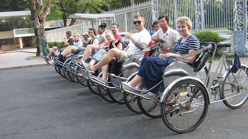 people on pedal vehicles