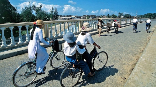 locals traveling by bicycles in Hue
